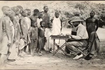 N O Moore typing a letter home. Nyasaland (now Malawi), c 1872-c 1890.